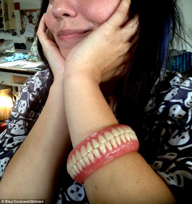 Model wears a bracelet made of teeth